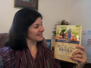 Bringing history to life, Angela Breidenbach holds her new book, Blue Ribbon Brides.
